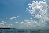 Pará State, Brazil. Clouds over the wide river below Vitoria do Xingu.