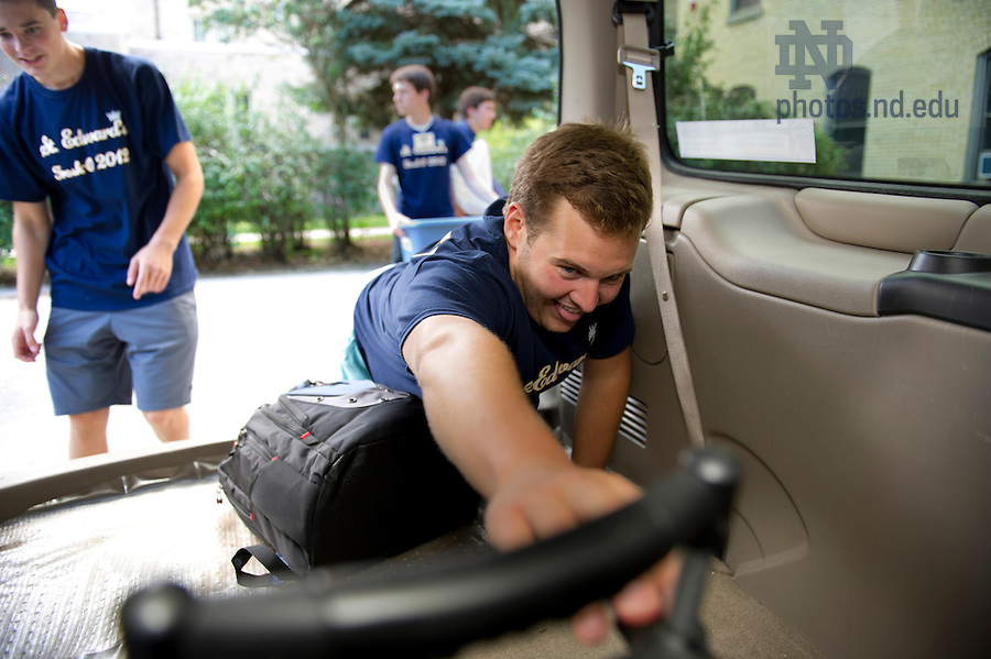 August 17, 2012; Members of the St. Edward's Hall orientation staff unload an SUV during move in day.  Photo by Barbara Johnston/University of Notre Dame