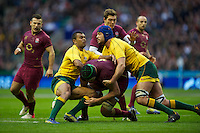 Tom Palmer of England is tackled by Kurtley Beale (left) and Nathan Sharpe of Australia during the Cook Cup between England and Australia, part of the QBE International series, at Twickenham on Saturday 17th November 2012 (Photo by Rob Munro)