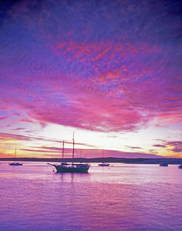 Sailboats and sunset at Morro Bay, California