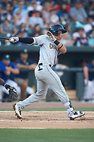 Oswaldo Cabrera (10) of the Charleston RiverDogs follows through on his swing against the Columbia Fireflies at Spirit Communications Park on June 9, 2017 in Columbia, South Carolina.  The Fireflies defeated the RiverDogs 3-1.  (Brian Westerholt/Four Seam Images)