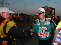 Jul. 1, 2012; Joliet, IL, USA: NHRA  funny car driver John Force (right) congratulates Jeff Arend after winning the Route 66 Nationals at Route 66 Raceway. Mandatory Credit: Mark J. Rebilas-