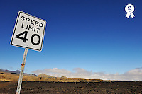 Speed limit sign on Mauna Kea volcano slopes, Speed limit sign on Mauna Kea volcano slopes, Big Island, Usa (Licence this image exclusively with Getty: http://www.gettyimages.com/detail/85985778 )