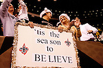 December 2009: New Orleans Saints fans watch an NFL football game between the Saints and the Dallas Cowboys at the Louisiana Superdome in New Orleans.