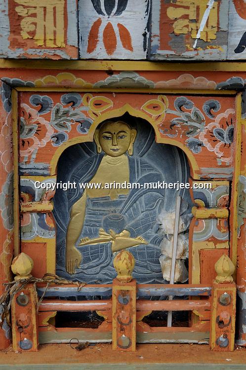 A Buddhist painting on a chorten(religious mound like structure) at Dochula . Arindam Mukherjee..