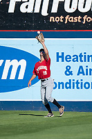 Vancouver Canadians left fielder Tanner Kirwer (19) catches a fly ball during a Northwest League game against the Spokane Indians at Avista Stadium on September 2, 2018 in Spokane, Washington. The Spokane Indians defeated the Vancouver Canadians by a score of 3-1. (Zachary Lucy/Four Seam Images)