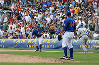August 9, 2009:  First Baseman Steve Clevenger of the Iowa Cubs gets the throw to record the final out on Howie Clark as pitcher Blake Parker looks on during a game at Wrigley Field in Chicago, IL.  Iowa is the Pacific Coast League Triple-A affiliate of the Chicago Cubs.  Photo By Mike Janes/Four Seam Images
