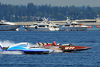 """Chip Hanuauer, U-787 """"Boeing"""" (powered by the """"green"""" bio fuel Camelina) and (R) original driver Mira Slovak (white helmet) and driver David Williams in the U-77 """"Miss Wahoo"""" (Replica of the vintage 1956 hull built in 2009)..1-2 August, 2009 Seattle, Washington USA..©2009 F.Peirce Williams USA.."""