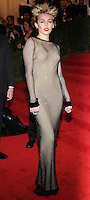 """NEW YORK, NY - MAY 06: Miley Cyrus arrives at the """"PUNK: Chaos To Couture"""" Costume Institute Gala held at the Metropolitan Museum of Art on May 6, 2013 in New York City. (Photo by Celebrity Monitor)"""