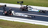 Apr 14, 2019; Baytown, TX, USA; NHRA top fuel driver Austin Prock (near) races alongside Jordan Vandergriff during the Springnationals at Houston Raceway Park. Mandatory Credit: Mark J. Rebilas-USA TODAY Sports