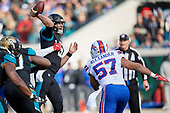 Jacksonville Jaguars quarterback Blake Bortles (5) passes under pressure by Lorenzo Alexander (57) during an NFL Wild-Card football game against the Buffalo Bills, Sunday, January 7, 2018, in Jacksonville, Fla.  (Mike Janes Photography)