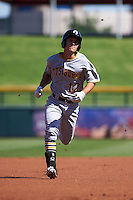 Glendale Desert Dogs outfielder Adam Frazier (12) running the bases during an Arizona Fall League game against the Mesa Solar Sox on October 14, 2015 at Sloan Park in Mesa, Arizona.  Glendale defeated Mesa 7-6.  (Mike Janes/Four Seam Images)