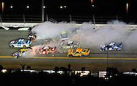 Feb 07, 2009; Daytona Beach, FL, USA; NASCAR Sprint Cup Series driver A.J. Allmendinger (44) drives through the middle as Kyle Busch (18), Denny Hamlin (11), Kasey Kahne (9), Jimmie Johnson (48) crash during the Bud Shootout at Daytona International Speedway. Mandatory Credit: Mark J. Rebilas-