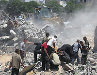 "Palestinians search for dead bodies under the rubble of a destroyed compound used by Hamas's Executive Force after an Israeli air strike in Gaza May 26, 2007. Israel pounded Hamas positions in the Gaza Strip on Saturday, killing at least four fighters, and seized a minister in Palestinian Prime Minister Ismail Haniyeh's cabinet, stepping up a campaign against the ruling Islamists.""photo by Fady Adwan"""