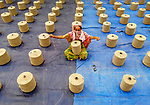 Hundreds of workers spend their day making thousands of string bags to transport rice, wheat and flour.  Aerial photos show them working in shifts, sitting part on tarpaulin sheets outside due to Coronavirus restrictions.<br /> <br /> Over the course of a day 1,200 workers will produce around 13,000 bags.  They can each hold up to 90kg, and are made from around 800 grams of string.  SEE OUR COPY FOR DETAILS.<br /> <br /> Please byline: Touhid Parvez Biplob/Solent News<br /> <br /> © Touhid Parvez Biplob/Solent News & Photo Agency<br /> UK +44 (0) 2380 458800
