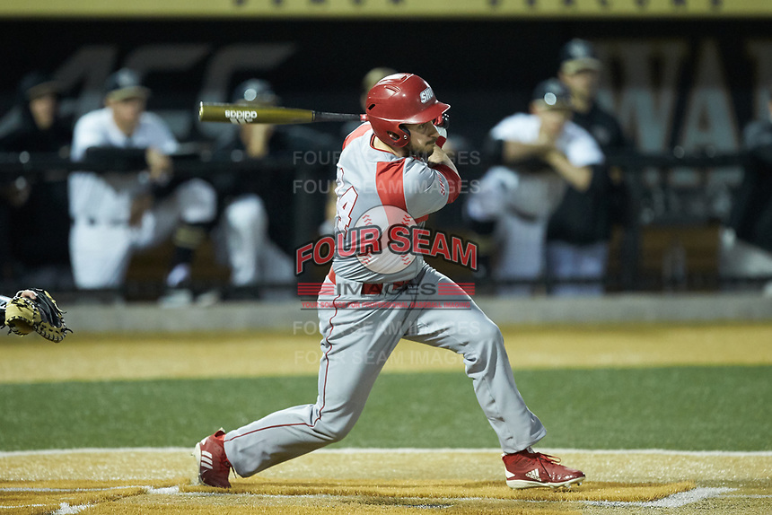 Austin Markmann (14) of the Sacred Heart Pioneers follows through on his swing against the Wake Forest Demon Deacons at David F. Couch Ballpark on February 15, 2019 in  Winston-Salem, North Carolina.  The Demon Deacons defeated the Pioneers 14-1. (Brian Westerholt/Four Seam Images)