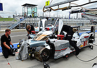 September 19, 2013: <br /> <br /> Personnel of Andre Lotterer (DEU) \ Benoit Treluyer  (FRA) \ Marcel Fassler (FRA) of Audi Sport Team Joest #1 LMP1 Audi R18 e-tron quattro work on the car during International Sports Car Weekend test and setup session at Circuit of the Americas in Austin, TX.