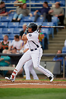 Binghamton Rumble Ponies right fielder Jhoan Urena (24) follows through on a swing during a game against the Erie SeaWolves on May 14, 2018 at NYSEG Stadium in Binghamton, New York.  Binghamton defeated Erie 6-5.  (Mike Janes/Four Seam Images)