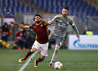 Calcio, andata degli ottavi di finale di Champions League: Roma vs Real Madrid. Roma, stadio Olimpico, 17 febbraio 2016.<br /> Roma's Mohamed Salah, left, is challenged by Real Madrid's Sergio Ramos during the first leg round of 16 Champions League football match between Roma and Real Madrid, at Rome's Olympic stadium, 17 February 2016.<br /> UPDATE IMAGES PRESS/Isabella Bonotto