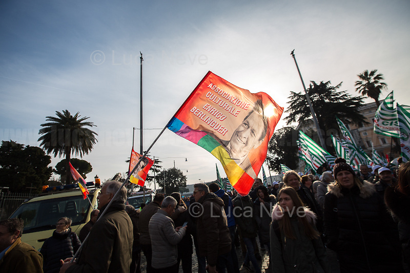 """Enrico Berlinguer (Historical Leader of the PCI, Italian Communist Party who suffered a brain hemorrhage during a speech at a public meeting in Padua, he died four days later, on 11 June 1984) flag.<br /> <br /> Rome, 09/02/2019. Today, hundreds of thousands of people marched from Piazza della Repubblica to Piazza San Giovanni for the National Demonstration """"Futuro al Lavoro"""" (A word pun which means: Future At Work and A Future for Work) organised by the three main Italian Trade Unions: CGIL (Italian General Confederation of Labour, General Secretary Maurizio Landini, 1.), CISL (Italian Confederation of Workers' Trade Union, General Secretary Annamaria Furlan, 2.), UIL (Italian Labour Union, General Secretary Carmelo Barbagallo, 3.). The demonstration - the biggest held in Italy in the last 4 years (4.) - was called against the economic policies and the pensions reform made by the Italian coalition Government, League - Five Star Movement (Lega - Movimento 5 Stelle, 5.). The three General Secretaries jointly asked the Government to implement less cautious pro-growth policies, to make a massive publicly and privately funded investments program, and to properly fight against poverty, and unemployment especially for the young people. In the fourth quarter of 2018 Italian economy contracted, leading the third-largest economy of the European Union into """"technical recession"""".<br /> <br /> Footnotes<br /> 1. http://cgil.it/ & https://bit.ly/2E1Al5a (Wikipedia)<br /> 2. https://www.cisl.it /& https://bit.ly/2tj5Txa (Wikipedia)<br /> 3. http://www.uil.it/ & https://bit.ly/2Glf88D (Wikipedia)<br /> 4. 1,300 coaches, 12 special trains, 2 special ferries from Sardinia (Sources - CGIL, CISL, UIL)<br /> 5. 01.06.18 - The New Italian Government https://bit.ly/2Q1NrU5"""