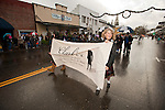 Former Ione Mayor Andrea Bonham Radogna walks down Main Street during Ione Business and Community Association's annualChristmas parade in the Mother Lode of Calif