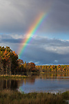 A pretty rainbow over a wilderness lake in northern Wisconsin.