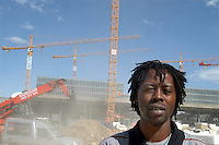- Senegal worker in the yard of new Milan fair at Rho-Pero....- operaio senegalese nel cantiere della nuova fiera di Milano a Rho-Pero
