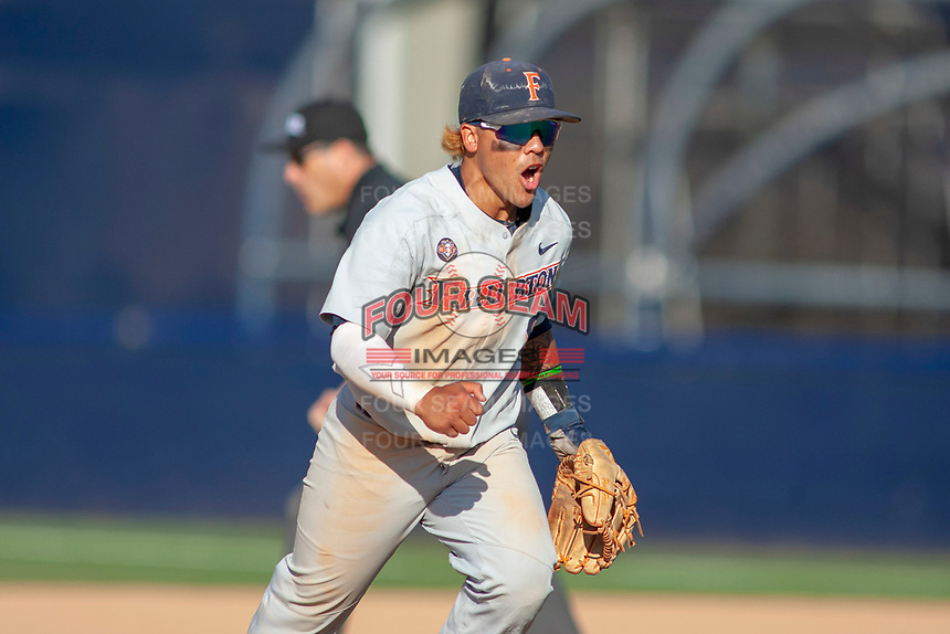 Cal State Fullerton Titans Hank LoForte (9) shows his enthusiasm during the game against the University of Washington Huskies at Goodwin Field on June 09, 2018 in Fullerton, California. The Cal State Fullerton Titans defeated the University of Washington Huskies 5-2. (Donn Parris/Four Seam Images)