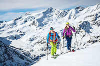 The Ortler Group in northern Italy is a popular region for spring ski touring using the huts for overnights to ski all the many peaks in the mountain group. Two ski tourers skinning to Monte Pasquale, 3553 meters.