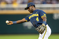 Michigan Wolverines second baseman Ako Thomas (4) makes a throw to first base in the ninth inning against the Florida State Seminoles during the NCAA College World Series on June 17, 2019 at TD Ameritrade Park in Omaha, Nebraska. Michigan defeated Florida State 2-0. (Andrew Woolley/Four Seam Images)
