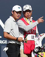 17th July 2021; Royal St Georges Golf Club, Sandwich, Kent, England; The Open Championship Golf, Day Three; amateur player Yuxin Lin (CHN) consults his caddie on the first tee