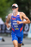 24 JUN 2012 - KITZBUEHEL, AUT - Alexander Bryukhankov (RUS) of Russia tries to cool himself with water during the run at the elite men's 2012 World Triathlon Series round in Schwarzsee, Kitzbuehel, Austria (PHOTO (C) 2012 NIGEL FARROW)