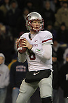 Marshall Lobbestael, Washington State quarterback, looks downfield for an open receiver during the Cougars 2009 Apple Cup football game against arch-rival Washington at Husky Stadium on November 28, 2010.