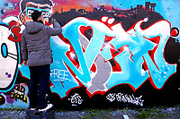 Initiative 'Writers united' to support the street artist Geco, recently identified, searched and reported to the police for damage to the city of Rome. To support the writer this morning many artists, gathered in Tor Bella Monaca, a suburban neighborhood of Rome and painted a long wall along the main street.<br /> Rome (Italy), December 20th 2020<br /> Photo Samantha Zucchi Insidefoto