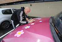 Pictured: Jonjo Shelvey signs the Suzuki Samurai at the Landore Training Ground. Saturday 10 May 2014<br />