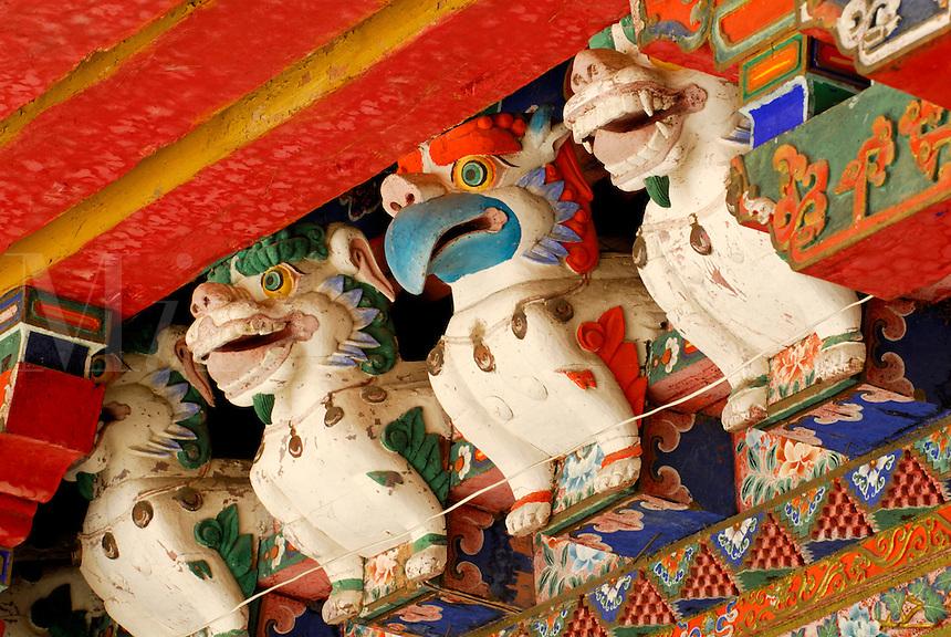 Carved animal protector deities guard the entrance to Kelsang Potrang, summer residence of the 18th century 8th Dalai Lama, at Norbulingka, founded by the 7th Dalai Lama in 1755, Lhasa, Tibet, China.