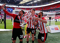 29th May 2021; Wembley Stadium, London, England; English Football League Championship Football, Playoff Final, Brentford FC versus Swansea City; Saman Ghoddos, Vitaly Janelt and Bryan Mbeumo of Brentford celebrate with the Sky Bet EFL Championship Plays-off Trophy and their 2-0 win and promotion to the Premier League