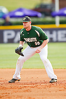 First baseman Grant Dunnegan (30) of the Charlotte 49ers on defense against the High Point Panthers at Willard Stadium on February 20, 2013 in High Point, North Carolina.  The 49ers defeated the Panthers 12-3.  (Brian Westerholt/Four Seam Images)