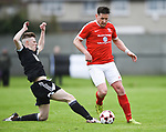 Paddy Purcell of Newmarket Celtic in action against Daniel O Neill of Janesboro during their Munster Junior Cup semi-final at Limerick. Photograph by John Kelly.
