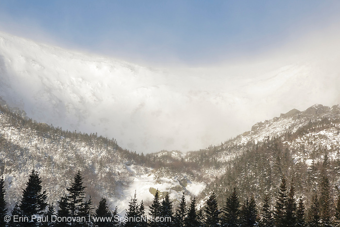 Mount Washington, Tuckerman Ravine in the White Mountains, New Hampshire USA in extreme weather conditions during winter months. Strong winds cause snow to blow across the mountain tops.