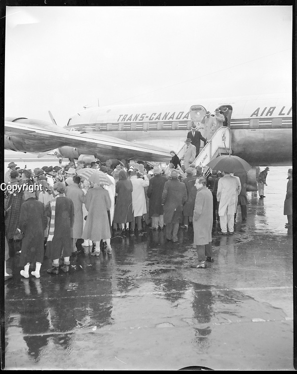 The Montreal team arrive for the 1955 Grey Cup in Vancouver, BC.<br /> <br /> <br /> Photo via Agence Quebec Presse