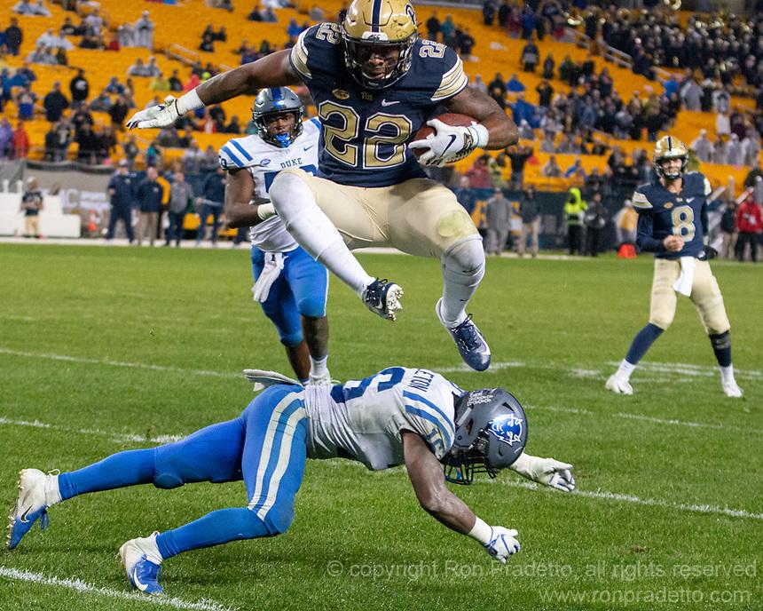 Pitt running back Darrin Hall hurdles Duke defensive back Dylan Singleton. The Pitt Panthers football team defeated the Duke Blue Devils 54-45 on November 10, 2018 at Heinz Field, Pittsburgh, Pennsylvania.