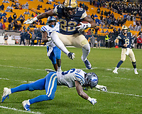 Pitt running back Darrin Hall hurdles Duke defensive back Dylan Singleton. The Pitt Panthers football team defeated the Duke Blue Devils 54-45 on November 10, 2018 at Heinz Field, Pittsburgh, Pennsylvania.