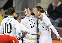 Alex Morgan #21 of the USA WNT with Carli Lloyd #10, Kristine Lilly #13 and Abby Wambach #20 after scoring the tying goal during an international friendly match against the PRC WNT at PPL Park, on October 6 2010 in Chester, PA. The game ended in a 1-1 tie.