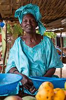 Senegal, Touba.  Woman Selling Mangoes at the Bus Station.