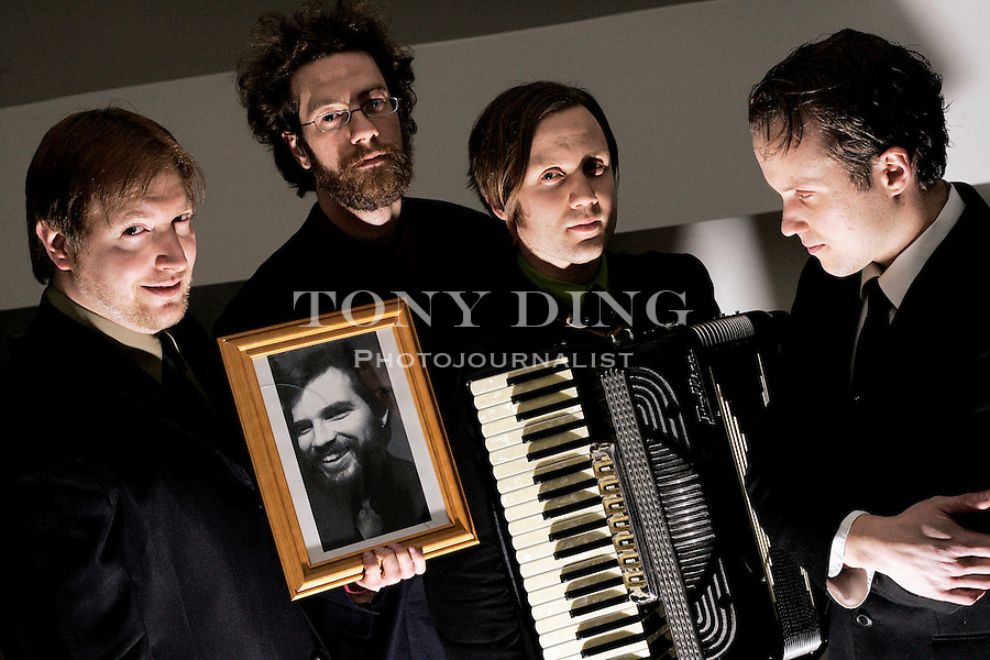 (From left) Scott McClintock, bass/piano, Greg McIntosh, guitar, Timothy Monger, accordion, and Jamie Monger, guitar, of the band Great Lakes Myth Society pose for a portrait at a rehearsal on Tuesday, February 1, 2006 in Ann Arbor, Mich. Fido Kennington, drums, is pictured in the frame held. The band uses the MySpace.com web site to promote their music. (AP Photo/Tony Ding)