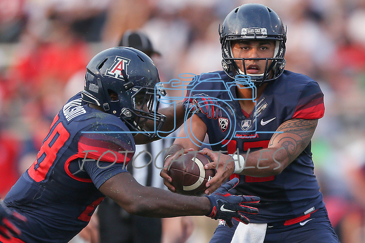 Arizona quarterback Anu Solomon (12) and running back Nick Wilson (28) compete against Nevada during the first half of an NCAA college football game in Reno, Nev. on Saturday, Sept. 12, 2015. (AP Photo/Cathleen Allison)