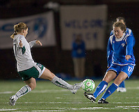 Boston Breakers defender Kasey Moore (17) passes as St Louis Athletica midfielder Lori Chalupny (17) defends. The Boston Breakers defeated Saint Louis Athletica, 2-0, at Harvard Stadium on April 11, 2009.