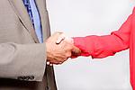 A businessman and businesswoman handshaking