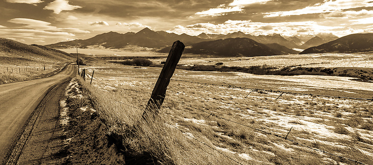 The Absaroka Mountains loom beyond the city of Livingston on Fleshman Creek Road